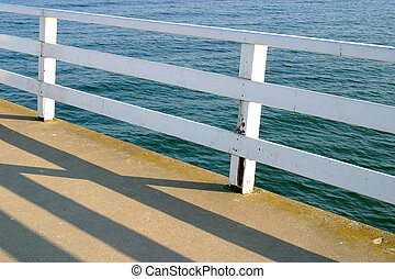 Pier Shadows 2 - Handrail shadows on a pier in Germany at...