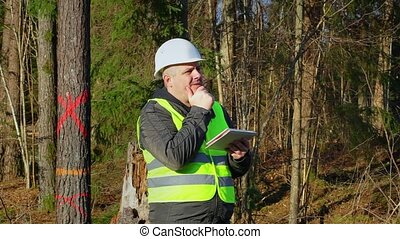 Thoughtful forest engineer to get idea in the forest