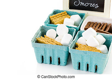Smores station with large white marshmallows at the party.