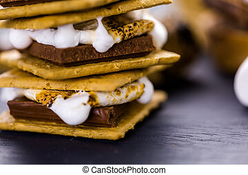 Smores - Freshly toasted smores with large white...