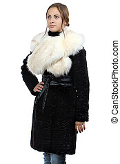 Photo of the young woman in fur coat