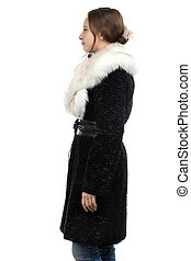Photo of the young woman in fur - profile