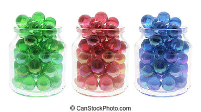 Marbles in Glass Jars on White Background