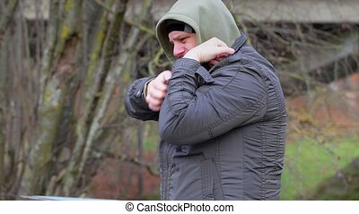 Man with itchy body at outdoors