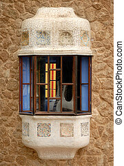 Window in the building designed by Antoni Gaudi, Barcelona Spain