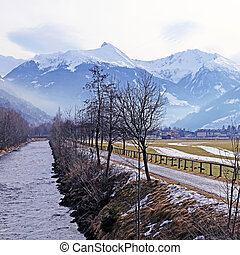 river, country road and Alps mountain in small...