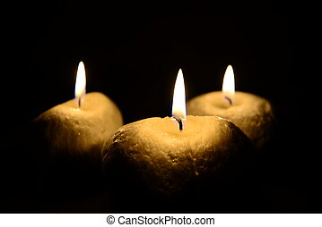 Three candles isolated on black - Photo of three candles...