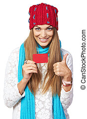 Winter woman with credit card showing thumb up - Happy...