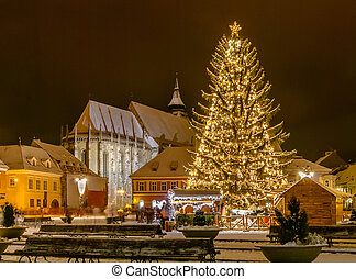 Brasov, Romania with an old Christmas tree - Old city square...