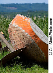 Old wooden boat on land