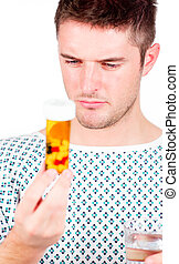 Patient holding a bottle of pills