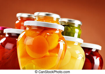 Jars with fruity compotes and jams Preserved fruits