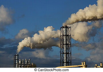 smoke from chimneys on a blue sky