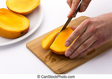 Subdividing The Mango Thirds Into Fruit Chips - Close up of...