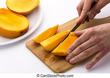 Mango Divided Into Thirds Being Subdivided Further - One...