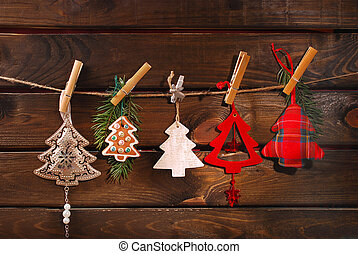 christmas tree shaped decoration collection hanging on twine...