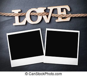 carved wooden letters love on a black background Place on a...