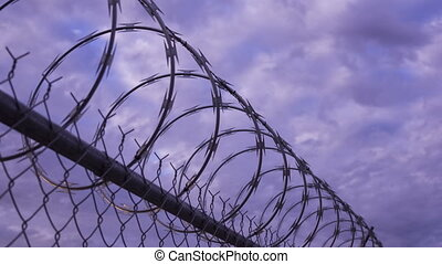 Razor Wire Timelapse - Dolly shot of the razor wire atop a...
