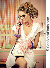 kitchen talking - Beautiful sexy pin-up girl talking on the...