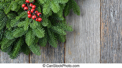 Tree branch with Holly Berry on rustic wooden background...