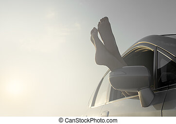 Female legs out of car window.