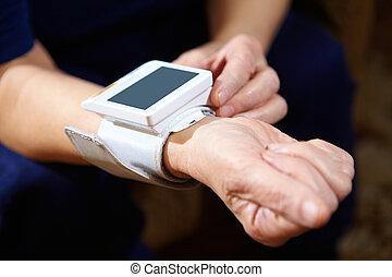 Blood pressure measuring. - Senior woman measuring blood...