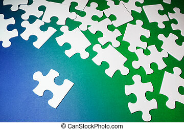 Jigsaw Puzzle Pieces on Blue and Green Background