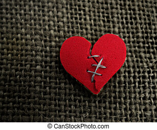 Red heart stitch - Red broken heart stitched with thread on...