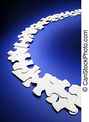 Row of Jigsaw Puzzle Pieces on Blue Background