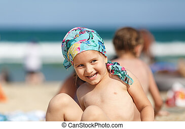 Laughing child - Laughing little girl on the beach. Focus on...