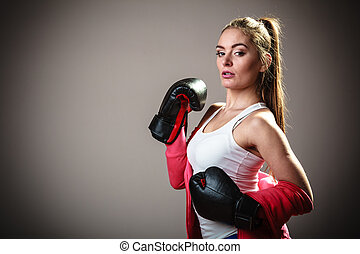 Sport boxer woman in black gloves boxing - Martial arts or...