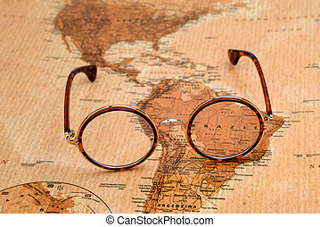 Glasses on a map of a world, Brazil - Photo of glasses on a...