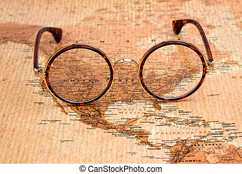 Glasses on a map of a world - USA - Photo of glasses on a...