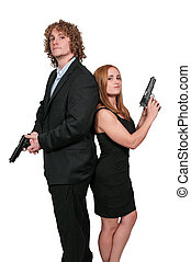 Couple with Guns - Young married couple with loaded handgun...
