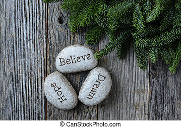 Hope, Dream, Believe in Christmas with Pine Needles on Rustic Wo