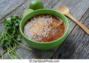 Tortilla Soup with Cheese, Lime, Cilantro and Wooden Spoon...