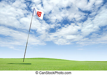 Hole 18 on a golf course - Golf flag at hole 18 on the...