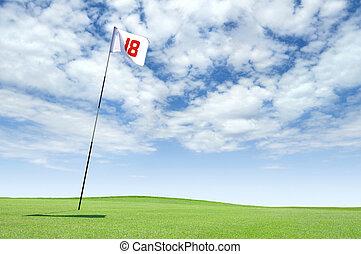 Hole 18 on a golf course - Golf flag at hole 18 on the...