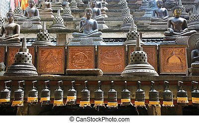 Gangaramaya Temple Colombo - buddha statues and prayer...