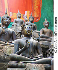 Gangaramaya Temple Colombo - buddha statues of the...