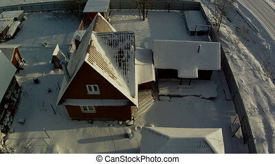 View from above on cottage village in wintertime
