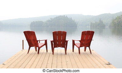 Three red chairs on dock. Misty. - Three red chairs on dock....