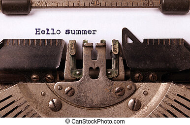 Vintage inscription made by old typewriter, hallo summer