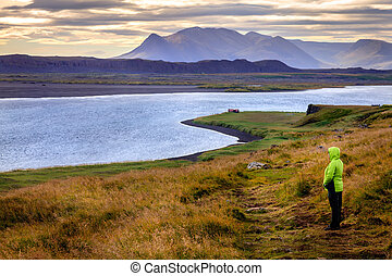Northwestern Iceland - A hiker on Vatnsnes Peninsula in...