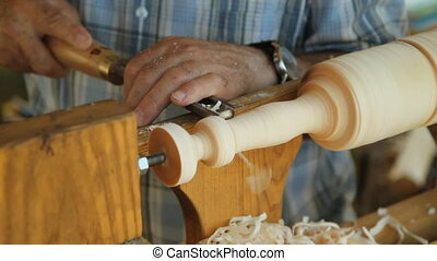 Foot operated spring pole lathe - Man operating a foot...