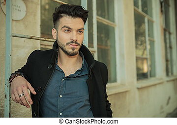 attractive young fashion man looking away