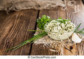 Homemade Herb Butter - Portion of fresh made herb butter on...