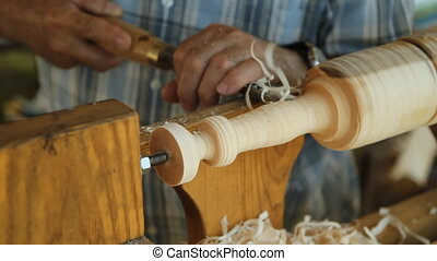 Foot operated spring pole lathe. - Man operating a foot...