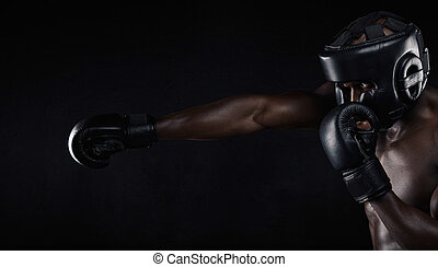 Young man practicing boxing - Image of african male boxer...