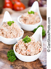 Fresh made Tuna Salad in a small bowl on wooden background